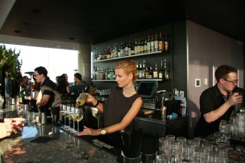 Bartender serves champagne at Thompson Toronto Rooftop, photo Clarissa Magalhaes