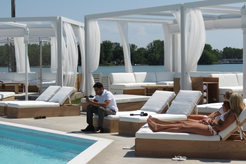 Women sunbathe at Cabana Pool Bar