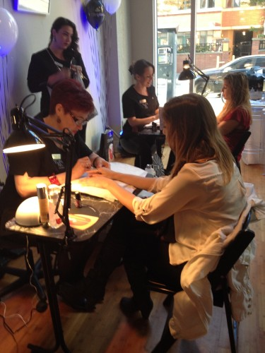 Guest enjoys a manicure at WaySpa Social event