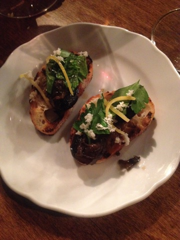 Escargot with Italian parsley, feta cheese and lemon zest on toasted French stick at Porzia