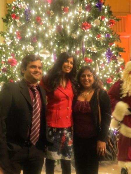 CP24's Pooja Handa poses with guests at Holiday tree lighitng party at King Edward Hotel