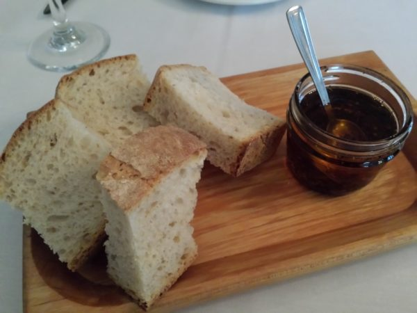 Fresh bread with spicy olive oil at Napoli Ristorante & Pizzeria