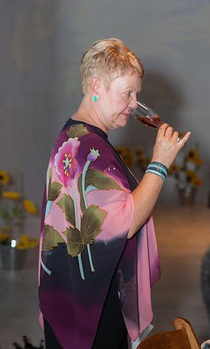 Lauren Simmons of Wine Behind the Scenes sniffs a glass of rose before tasting.