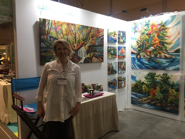 Artist Julia Veenstra uses colour in her paintings of Canadian landscapes at One of a Kind Craft Show 2016 in Toronto.