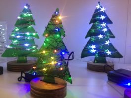 Fusion Art Christmas trees at Booth Y29 light up.
