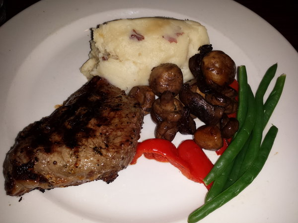 Top Sirloin Keg Classics with garlic mashed potato, sauteed mushrooms and vegetables