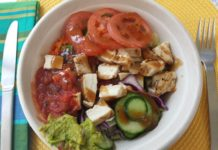 Harvey's Build-A-Bowl with salad, chicken, guacamole, salsa, cucumber, tomato and Asian Sesame dressing
