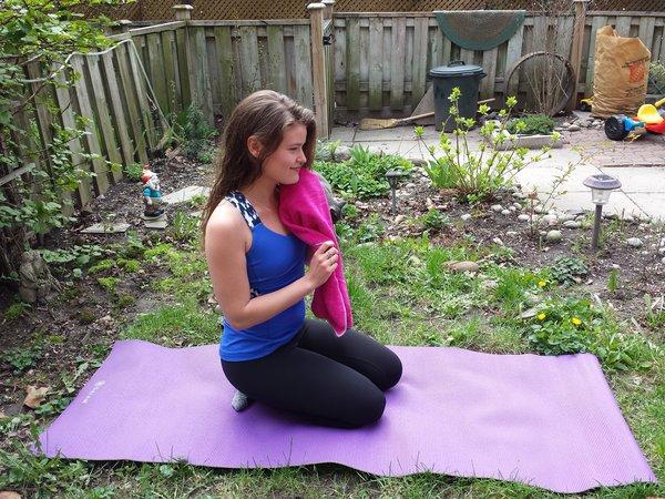 Gaiam yoga hand towel, $12.99, soaks up the sweat.