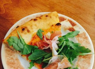 Single slice of pizza at Extraordinary Italian Taste at Cibo Restaurants