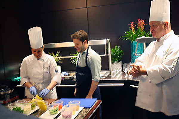 Grace Di Fede, Chef de Cuisine and Shawn Whalen, Executive Chef, demonstrate cooking technique during Summerlicious at Azure Restaurant