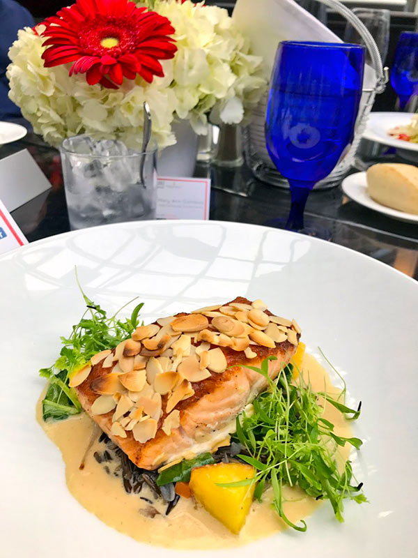 Maple Almond-Crusted Salmon with wild rice, arugula, sauteed stone fruit and mirabelle plum nage at Summerlicious at Azure Restaurant