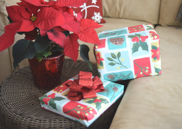 Gifts wrapped in PAPYRUS Eco Friendly Blocked Foliage Holiday Roll