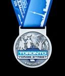 Finisher Medals for Toronto Yonge Street 10K, photo runCRS.ca