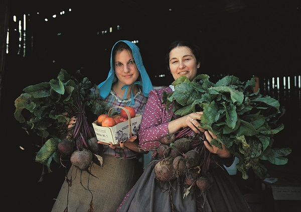 Women Carrying Crops at Pioneer Harvest Festival