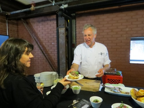 Chef Brad Long serves food for Beautiful Heat event at the Brick Works