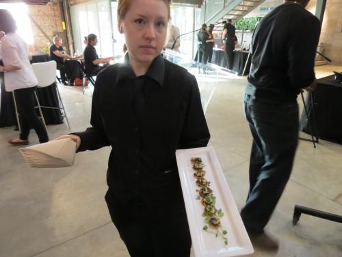 Server offers Chicken and Black Bean Tostadas