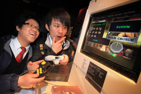 Boys playing Random game at Ontario Science Centre, photo Brian Willer