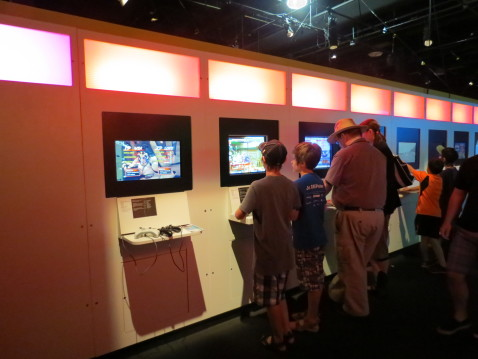 Visitors play video games at Game On 2.0 at Ontario Science Centre