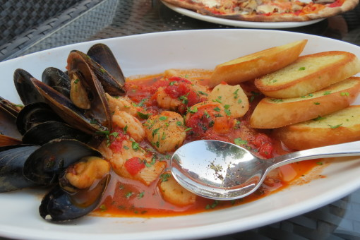 Shrimps, scallops, mussels and tilapia in a white wine bouillabaise