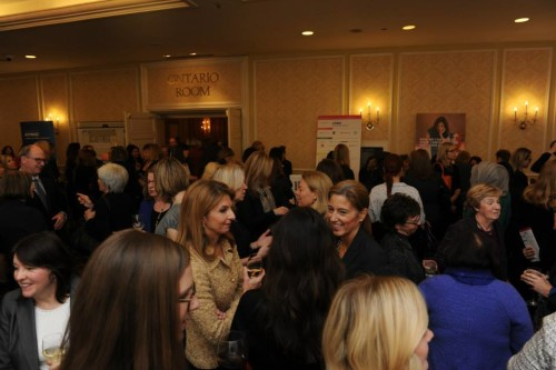 Guests mingle at Women for Women's luncheon at Fairmont Royal York