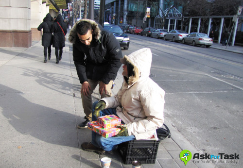 AskForTask volunteer provides meal to homeless person