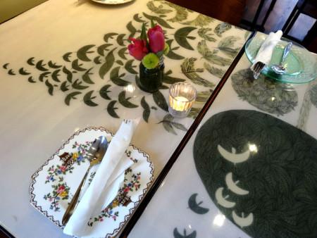 Tables at Wind Up Bird Cafe, photo Diana Condolo
