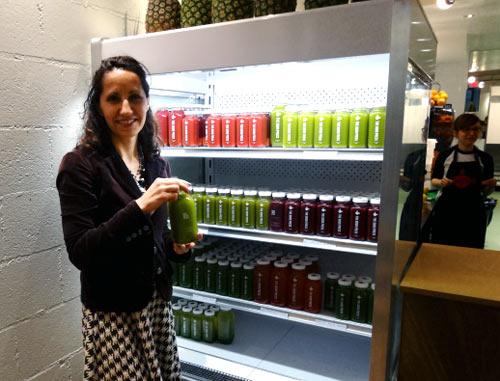 Selecting a juice at The Good Press juice bar