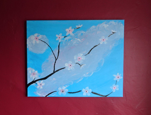 My Paint Nite cherry blossom painting is hanging on a wall, spreading cheer. It looks better in person. Really.