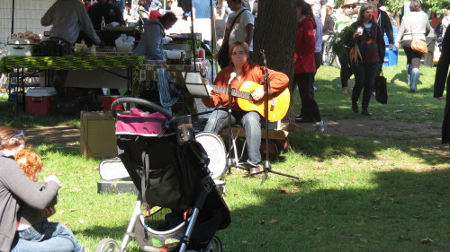 A singer-guitarist entertains the crowd