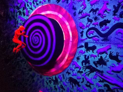 Suspended doll and spiral circle at Come Up To My Room