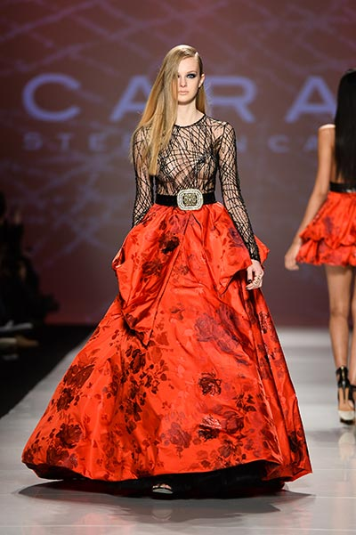A heavy, long red skirt contrasts with a see-through black top by Stephan Caras, photo George Pimentel