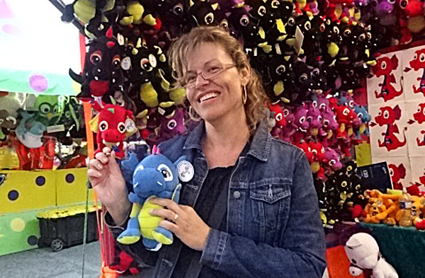 Winning a stuffed animal at dart games at the CNE