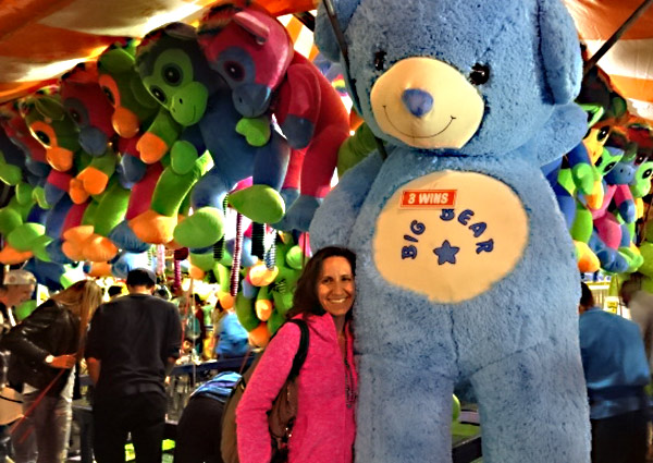 Winning giant teddy bear at dart games at the CNE
