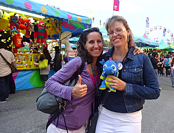 Winning a prize at dart games at the CNE