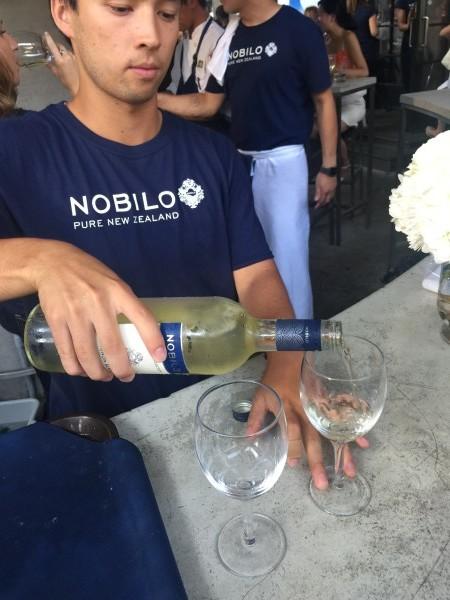 Bartender pours a glass of Nobilo Sauvignon Blanc