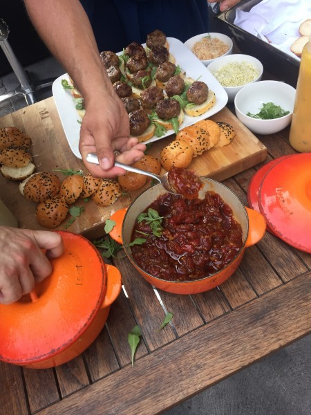 Lamb sliders with tomato jam on an onion bun at Oliver & Bonacini Cafe