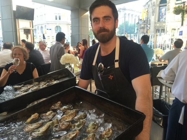 Serving oysters at Oliver & Bonacini Cafe Nobilo wine tasting