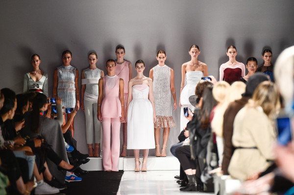 Models gather at the end of the Matthew Gallagher Show at World MasterCard Fashion Week 2015, photo credit George Pimentel