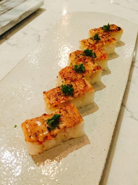 Aburi Salmon Oshi features pressed B.C. wild sockeye salmon, Miku signature sauce and jalapeno.