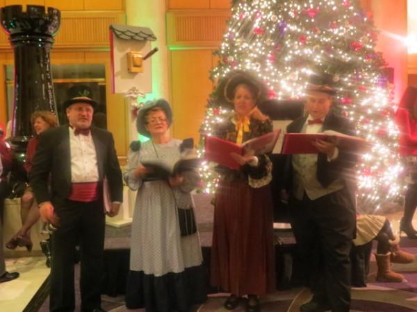 Quartet singing Christmas carols at Omni King Edward Hotel tree lighting party
