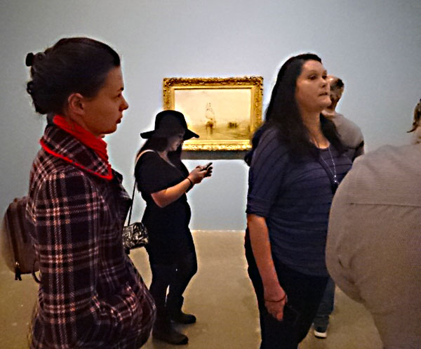 Group enjoying J.M.W. Turner exhibit at the Art Gallery of Ontario