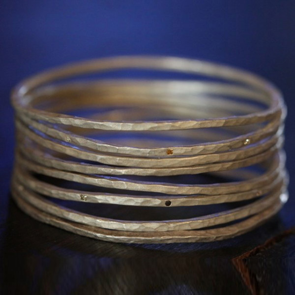 Hammered Bangles by Reuven Kassai Designs, from $225