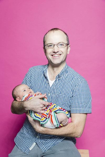 Toronto City Councillor Mike Layton poses with baby for Pride Toronto 2016, photo Raina Wilson