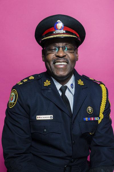 Toronto Police Chief Mark Saunders poses for Pride Toronto 2016