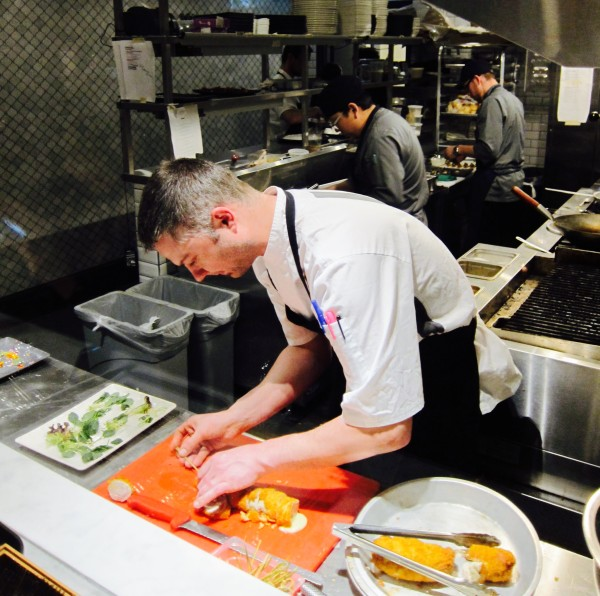 Chef in kitchen at Entice Lounge, Toronto