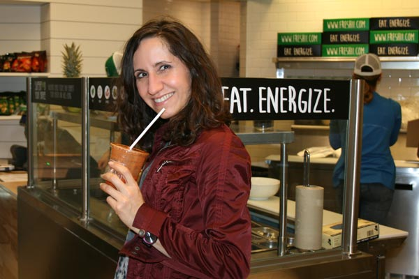 Diana enjoys a Carrot Zinger Juice at Freshii Liberty Village