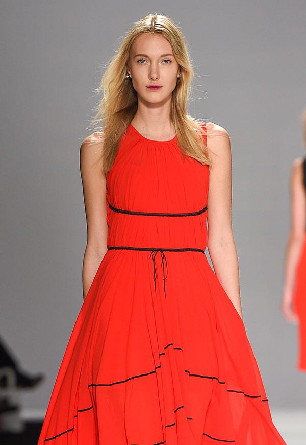 Flouncy red dress with black trim from Jennifer Torosian FW 2016 show at Toronto Fashion Week, photo credit George Pimentel