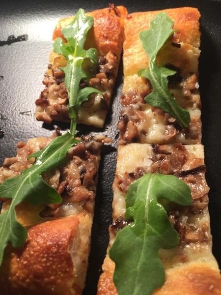 Funghi Pizza with mixed mushrooms, arugula, truffle oil and fontina at cresta toronto