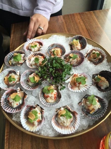 Scallop Crudo with citrus, coriander and garlic chips at cresta toronto