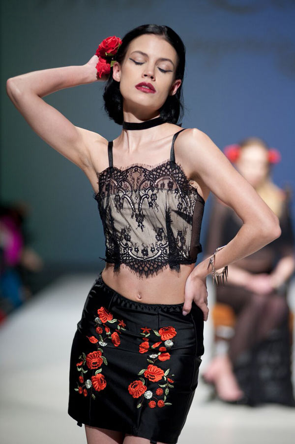 Black Satin with red roses on the skirt pairs beautifully with black lace on top from With Love Lingerie Collection at Fashion Art Toronto 2016, photo Jonathan Hooper